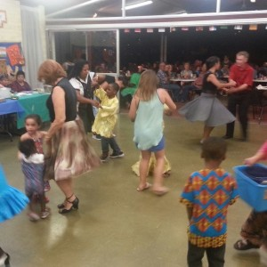 People of all ages dancing to the different cultural music in the 2015 International dinner.